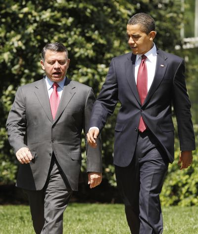 President Barack Obama walks with King Abdullah of Jordan after their meeting in the Oval Office of the White House in Washington on Tuesday.  (Associated Press / The Spokesman-Review)