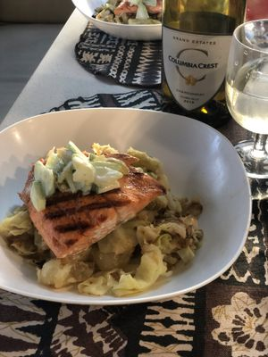 Fried potatoes and cabbage make a fine foundation for a cast iron skillet-seared wild salmon fillet. (Leslie Kelly)