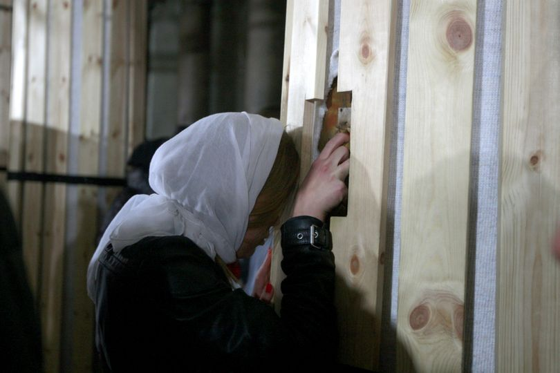 A Christian pilgrim touches a column inside the Church of the Nativity, believed by Christians to be the birthplace of Jesus Christ, in the town of Bethlehem on Tuesday. (Associated Press)