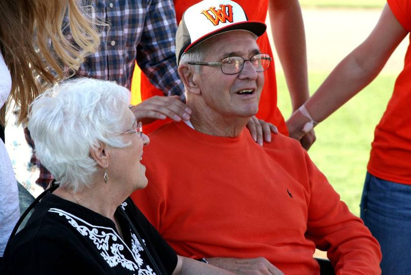 Jack Spring and his wife, Vona, sit together during the dedication of the West Valley High School baseball field in Spring's honor on Friday. (Steve Christilaw)