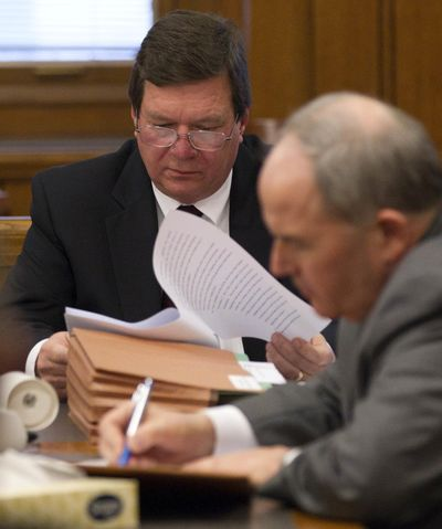 FILE - In this, Thursday, Jan. 12, 2012, file photo, David Holloway, left, looks over papers as he sits with his attorney Mark White during a probate hearing in Birmingham, Ala. The father of Natalee Holloway,  missing in Aruba since 2005 is denying his ex-wife's claims that a television show about the case was faked. (AP Photo/Dave Martin, File) ORG XMIT: ALDM106 (Dave Martin / AP)