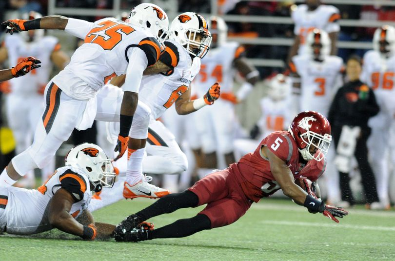 Washington State receiver Rickey Galvin runs the ball against Oregon State during a Pac 12 football game on Saturday, October 12, 2013, at Martin Stadium in Pullman, Wash. Oregon State led 17-10 at the half. (Tyler Tjomsland / The Spokesman-Review)