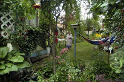 The view into the backyard garden of Viktoria Bruens shows  years of work planting and pruning.  (Photos by Christopher Anderson/ / The Spokesman-Review)