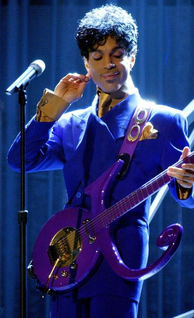 "Prince performs ""Purple Rain"" as the opening act during the 46th Annual Grammy Awards show on Feb. 8, 2004 at the Staples Center in Los Angeles. Warner Bros. Records and the Prince Estate just released a recording from Prince's archive of unreleased songs called ""Piano & a Microphone 1983."" (Richard Hartog / Richard Hartog/Los Angeles Times)"