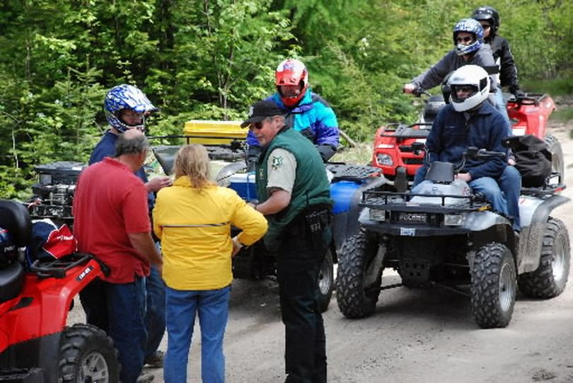 Mike Mumford, Colville National Forest law enforcement officer, talks with a group of ATV riders during his Memorial Day weekend patrol in Pend Oreille County. The riders were on a road that is closed to ATV traffic.  (Rich Landers)