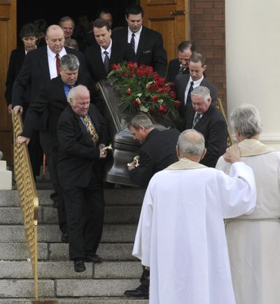 Harry Magnuson's casket is carried down the steps of St. Aloysius Church after his funeral Thursday in Spokane.   (Dan Pelle / The Spokesman-Review)