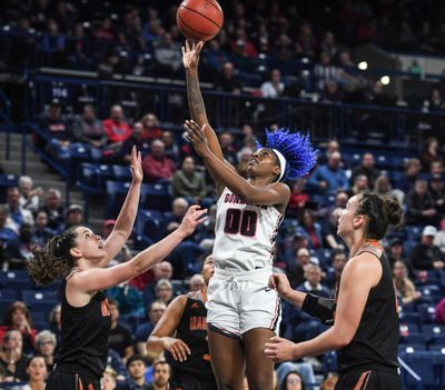 Gonzaga forward Zykera Rice hits a shot against Idaho State forwards Grace Kenyon, left, and Sai Tapasa on Tuesday  at the McCarthey Athletic Center. (Dan Pelle / The Spokesman-Review)