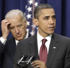 President Barack Obama, joined by Vice President Joe Biden at left, speaks Friday before signing the bipartisan tax package.  (Associated Press)