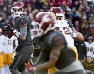WSU quarterback Luke Falk (4) looks for an open teammate against Arizona State during the first half of a Pac-12 college football game on Saturday, Nov 7, 2015, at Martin Stadium in Pullman, Wash. (Tyler Tjomsland / The Spokesman-Review)