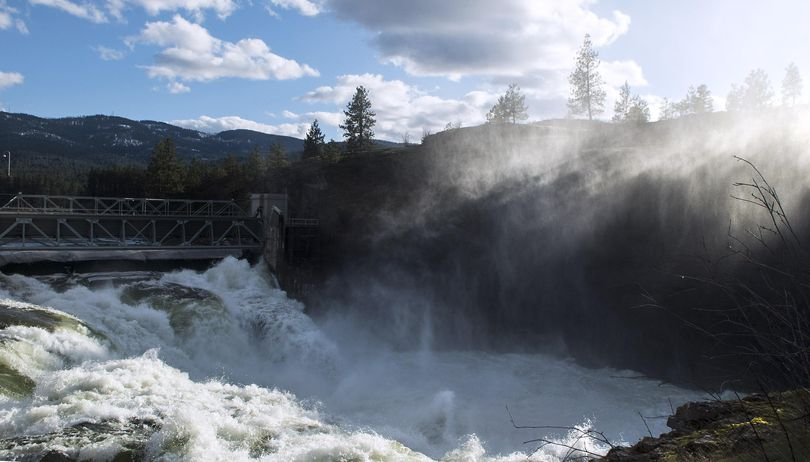 Water from the Spokane River makes it's way through the Post Falls dam floodgates while the spring thaw continues on Thursday, March 16, 2017. (Kathy Plonka / The Spokesman-Review)
