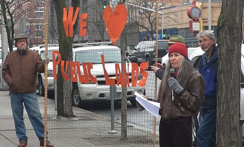 Gloria Flora, former national forest supervisor, speaks to a group of about 60 people supporting  federal public lands in a noon rally at the Federal Courthouse in downtown Spokane. (Rich Landers / The Spokesman-Review)