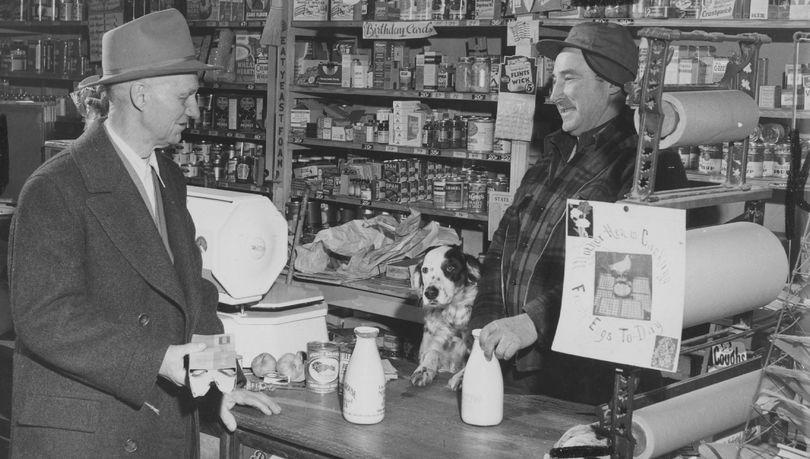 This photo was taken in 1949 in Elberton, Wash., in Whitman County by Spokane Chronicle photographer Sherm Blake. Blake was doing a story on the demise of the Country Store in the area. The owner of the store, D.A. Davison and his dog, are waiting on H.R. Taylor.