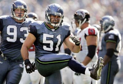Seattle's Lofa Tatupu (51) reacts after sacking Falcons quarterback Michael Vick in the second quarter of Seattle's 21-18 victory over Atlanta.   (Associated Press / The Spokesman-Review)
