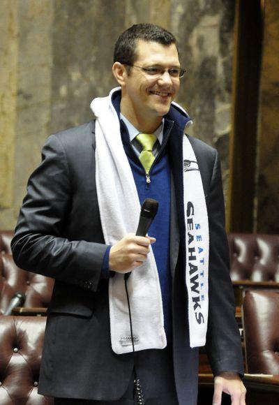 Majority Floor Leader Joe Fain, R-Auburn, sports a hooded scarf while moving the Senate through Friday morning's session. (Jim Camden)
