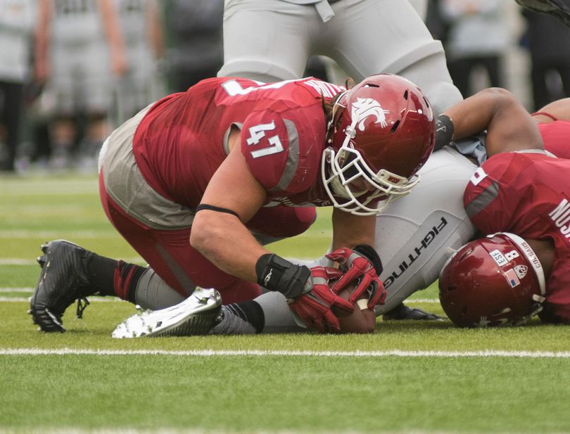 Cougars middle linebacker Peyton Pelluer has been a mainstay for Washington State's defense. (Associated Press)