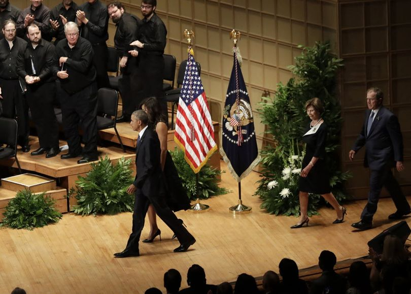 President Barack Obama and first lady Michelle Obama, followed by former President George W. Bush and Laura Bush, arrive for a memorial service at the Morton H. Meyerson Symphony Center, Tuesday, in Dallas. Five police officers were killed and several injured during a shooting in downtown Dallas last Thursday night. (AP Photo/Eric Gay)
