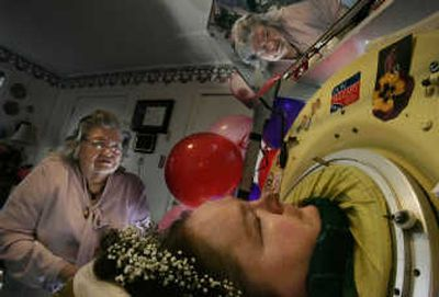 Dianne Odell chats with her mother, Geneva Odell, via a mirror mounted above her iron lung at home in Jackson, Tenn., in 2007. Associated Press  (Associated Press / The Spokesman-Review)