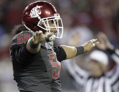 Washington State lineman Lyman Faoliu is part of a Cougars defense that is ranked in the top 10 nationally. (Associated Press)