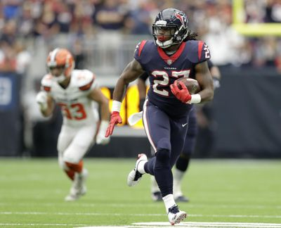 In this Sunday, Oct. 15, 2017 photo, Houston Texans running back D'Onta Foreman (27) breaks out for a long run against the Cleveland Browns in the first half of an NFL football game in Houston. Two days after being cut by the Texans, the third-year running back made it onto the field in suburban Indianapolis eager to prove he can still play in the NFL. (Eric Gay / Associated Press)