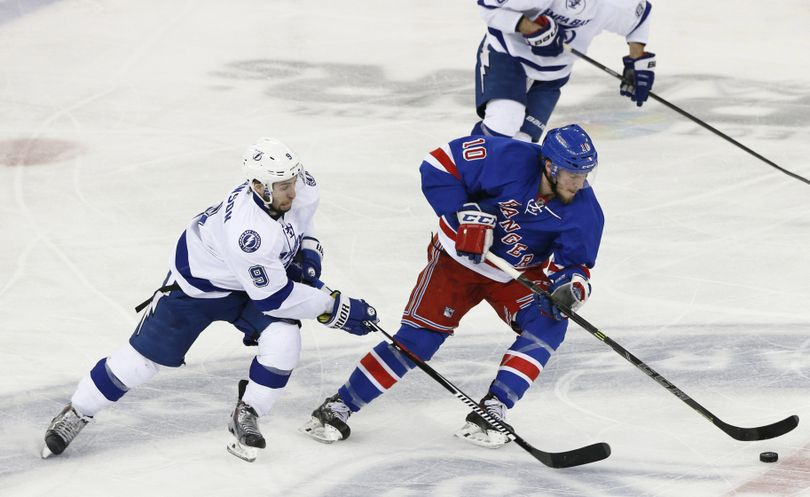 Rangers center J.T. Miller, right, maintains control of the puck as Lightning center Tyler Johnson defends. (Associated Press)
