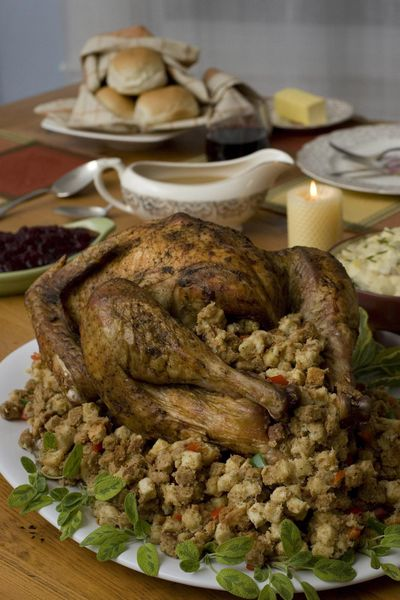 A turkey with stuffing is the traditional Thanksgiving meal, but it can be time-consuming and even daunting for a novice cook. Luckily, lots of restaurants are willing to do that work for you. (LARRY CROWE / AP)