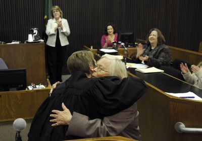 Judge Sara Derr gives Kathleen Wheaton  a hug of after Wheaton received her diploma after graduation from the Spokane County mental health court Wednesday.   (Dan Pelle / The Spokesman-Review)