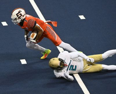Shock Wide Receiver Troy Evans (7) breaks a tackle from Massachusetts defensive back Khalid Wooten (2) to score a touchdown in the second period July 31 at the Arena.  (COLIN MULVANY/THE SPOKESMAN-REVIEW)
