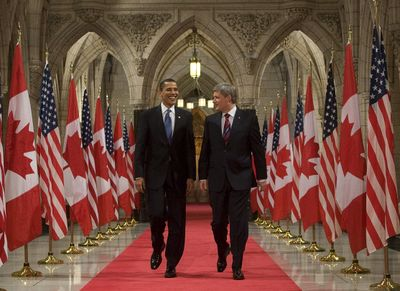 President Barack Obama and Canadian Prime Minister Stephen Harper walk down the Hall of Honour for a joint news conference on Parliament Hill in Ottawa on Thursday.  (Associated Press / The Spokesman-Review)