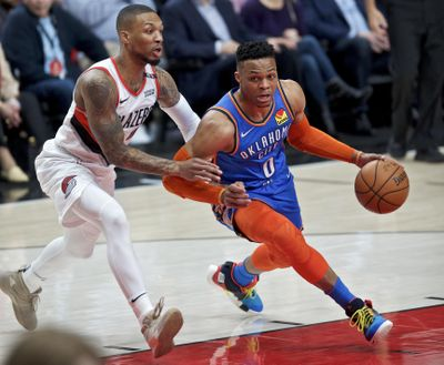 Oklahoma City Thunder guard Russell Westbrook, right, dribbles past Portland Trail Blazers guard Damian Lillard during the first half of Game 2 of an NBA basketball first-round playoff series Tuesday, April 16, 2019, in Portland, Ore. (Craig Mitchelldyer / Associated Press)