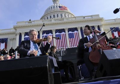 Violinist Itzhak Perlman, left, and cellist Yo-Yo Ma  perform to recorded music during the inauguration ceremony Jan. 20 of President Barack Obama. (Associated Press / The Spokesman-Review)