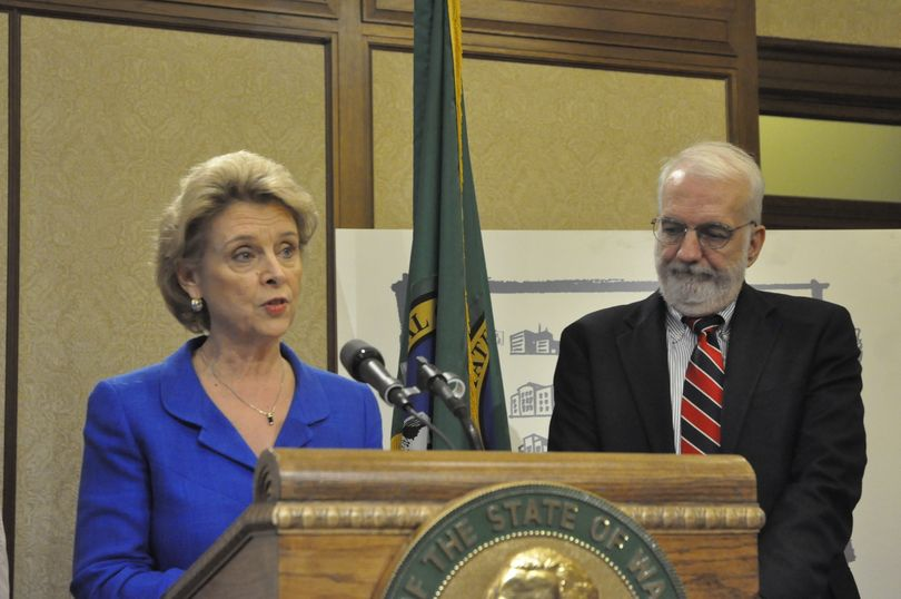 Gov. Chris Gregoire and OFM Director Marty Brown unveil the proposed 2011-13 state budget in Olympia on 12/15/2010 (Andrew Zahler)