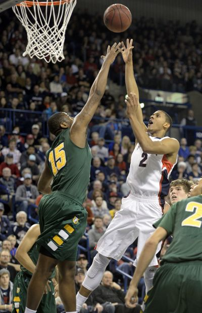 GU's Angel Nunez elevates in the paint to shoot over the Dons' Kruize Pinkins. (Jesse Tinsley)