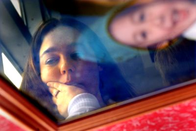 Holly Cork is reflected in an old photograph of her son, Angelo, who was taken away shortly after this picture was taken some eight years ago.  (File / The Spokesman-Review)