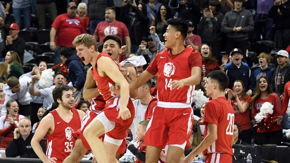 Brewster celebrates their 60-57 win over St. George's during a State 2B boys semifinal game on Friday, March 6, 2020, at the Spokane Arena. (Colin Mulvany / The Spokesman-Review)