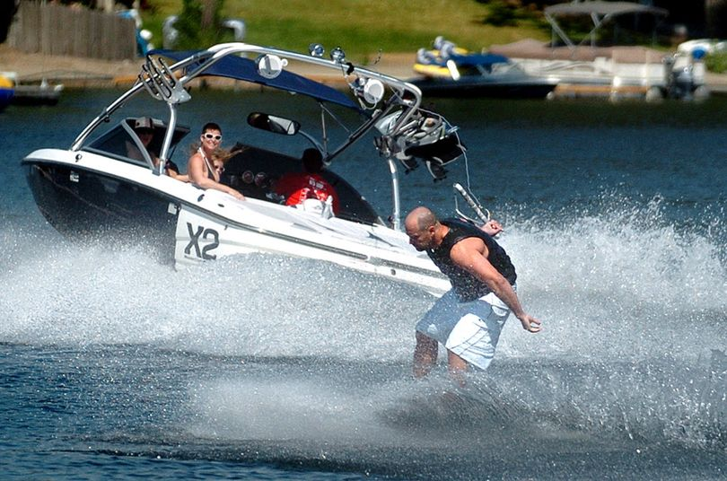 Wakeboarders get a boost from boats designed to create exceptionally large wakes. (The Spokesman-Review)