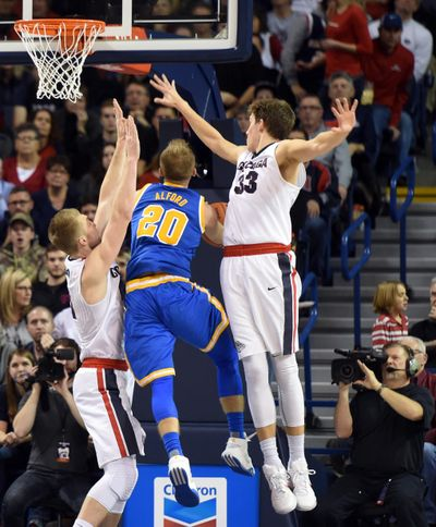 UCLA's Bryce Alford knifes between Gonzaga's Domantas Sabonis, left, and Kyle Wiltjer, right. The Gonzaga big men represent one of the strongest one-two punches in Zags' history. (Jesse Tinsley / The Spokesman-Review)