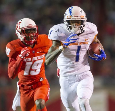 Boise State wide receiver Cedrick Wilson runs ahead of New Mexico defensive back Elijah Lilly on the way to one of three TD passes he caught from Brett Rypien. (Darin Oswald / Associated Press)