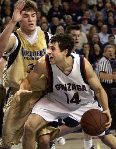 Brian Michaelson draws the foul from Northern Colorado's Sean Taibi.  (Jed Conklin / The Spokesman-Review)