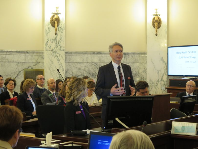 Russ Barron, director of the Idaho Department of Health & Welfare, addresses JFAC on Monday morning, Jan. 15, 2018, along with Deputy Director Lori Wolff, left, and state Insurance Director Dean Cameron, right. (Betsy Z. Russell)