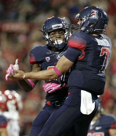 B.J. Denker, right, had 3 TDs for Arizona. (Associated Press)