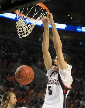 Austin Daye of Gonzaga bends down the rim with a second half dunk  against Akron in the opening round of the NCAA Tournament. (Christopher Anderson / The Spokesman-Review)