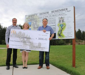Rathdrum McDonald's owners Tim and Terri Skubitz presented Coeur d'Alene Mayor Steve Widmyer with a check for $3,006.43 from the July 16 event. (Photo courtesy of city of Coeur d'Alene)