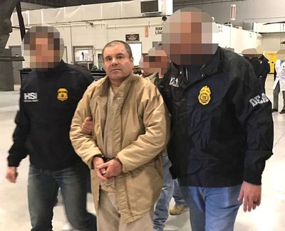 """Image provided by the Attorney General of the Republic (PGR) of Mexico shows drug lord Joaquin Guzman Loera, alias """"El Chapo""""  being extradited to the United States on January 19, 2017, and flown from a jail in Ciudad Juarez, Mexico, to Long Island MacArthur Airport in Islip, N.Y., to face charges. (PGR/Prensa Internacional / Tribune News Service)"""