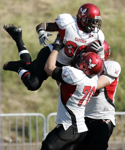 Eastern Washington running back Darriell Beaumonte, top, who started his first game, celebrates a touchdown with offensive lineman Steven Forgette during the Eagles' win over Weber State on Oct. 2, 2010, at Stewart Stadium in Ogden, Utah.  (AP/Nick Short)