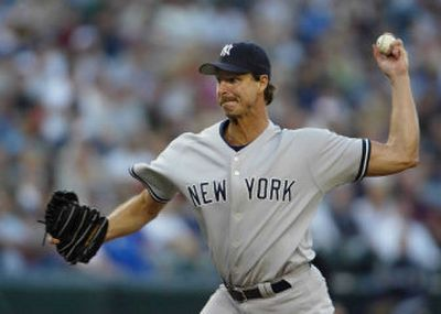 Yankees starter Randy Johnson works during the first inning.   (Associated Press / The Spokesman-Review)
