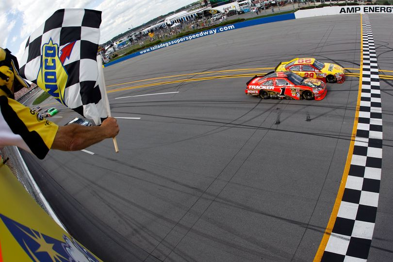 Kevin Harvick beats Jamie McMurray to the finish line by .011 seconds, the eighth-closest margin since the advent of electronic scoring in 1993, to win the Aaron's 499 at Talladega Superspeedway. (Photo courtesy  Todd Warshaw/Getty Images) (Todd Warshaw / Getty Images North America)