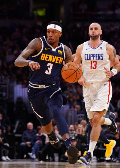 Denver Nuggets guard Torrey Craig drives the court against the Los Angeles Clippers during the third quarter Thursday night in Denver. (AP Photo/Jack Dempsey) ORG XMIT: OTK (Jack Dempsey / Associated Press)