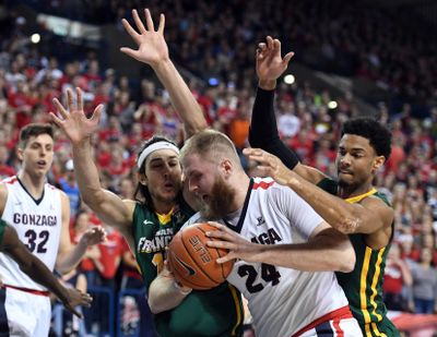 San Francisco forwards Matt McCarthy (left) and Nate Renfro try to keep Gonzaga center Przemek Karnowski (24) out of the key during the first half of an NCAA basketball game, Thurs., Feb. 16, 2017, in the McCarthey Athletic Center. (Colin Mulvany / The Spokesman-Review)