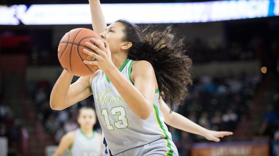 Mia Pakootas  of Inchelium goes to the basket in the State 1B final against Oakesdale on Saturday, March 7, 2020, in the Spokane Arena. The Inchelium Hornets took home their first State 1B title. (Libby Kamrowski / The Spokesman-Review)