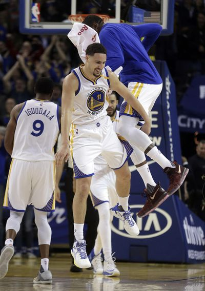 Warriors' Klay Thompson celebrates with Kevin Durant, right, after scoring 60 against the Pacers. (Ben Margot / Associated Press)